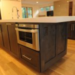 modern and minimalist kitchen island with sink and faucet and also microwave drawer  solidwood flooring for kitchen