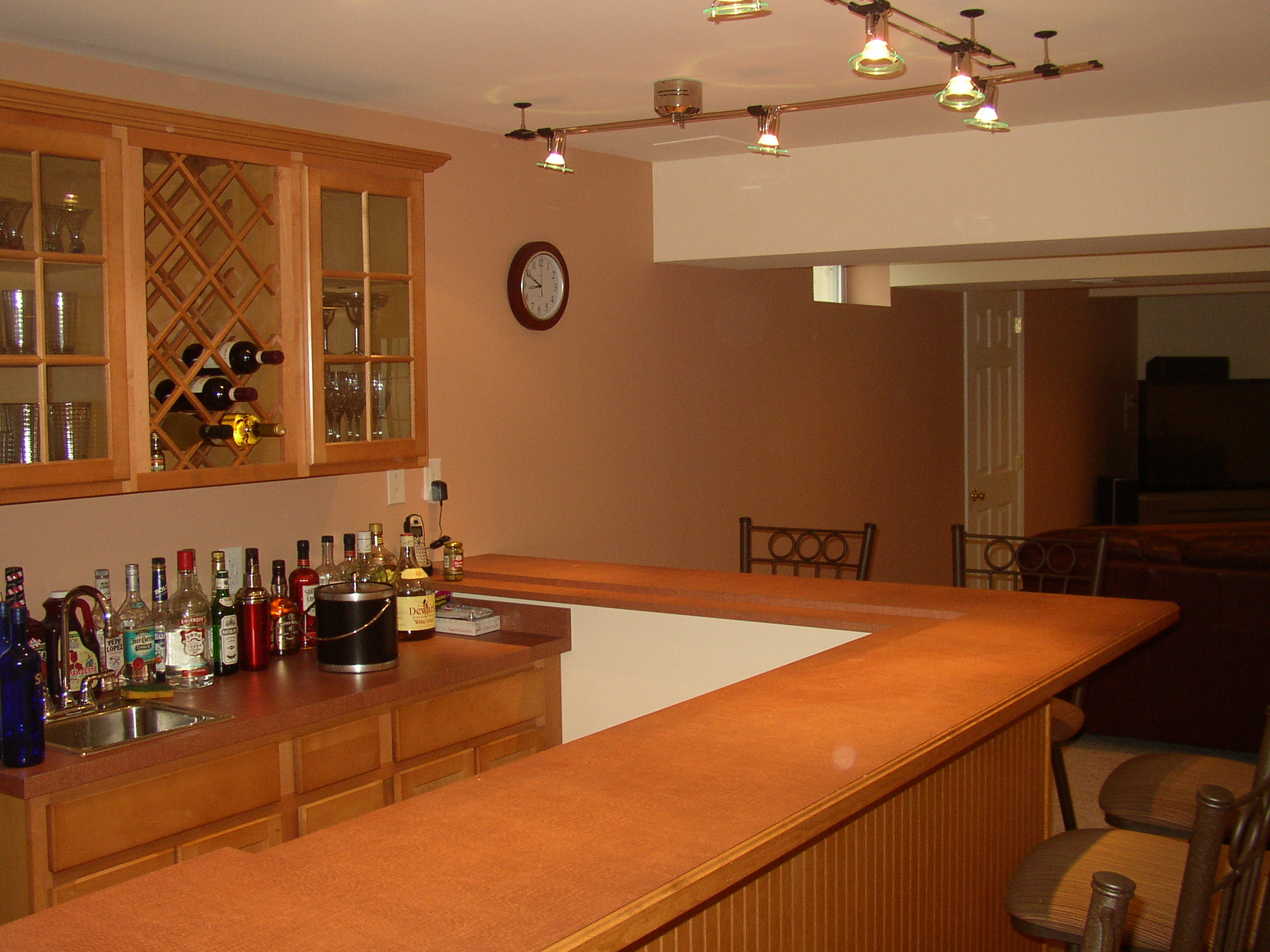 Modern Basement Wet Bar Design Ideas Uwith L Shaped Track Lighting And Mid  Century Bar Stools