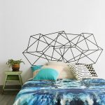 modern bedding design upon wooden flooring style aside small wooden table with blue dyied quilt and pillows beneath geometric wall headboard decoration