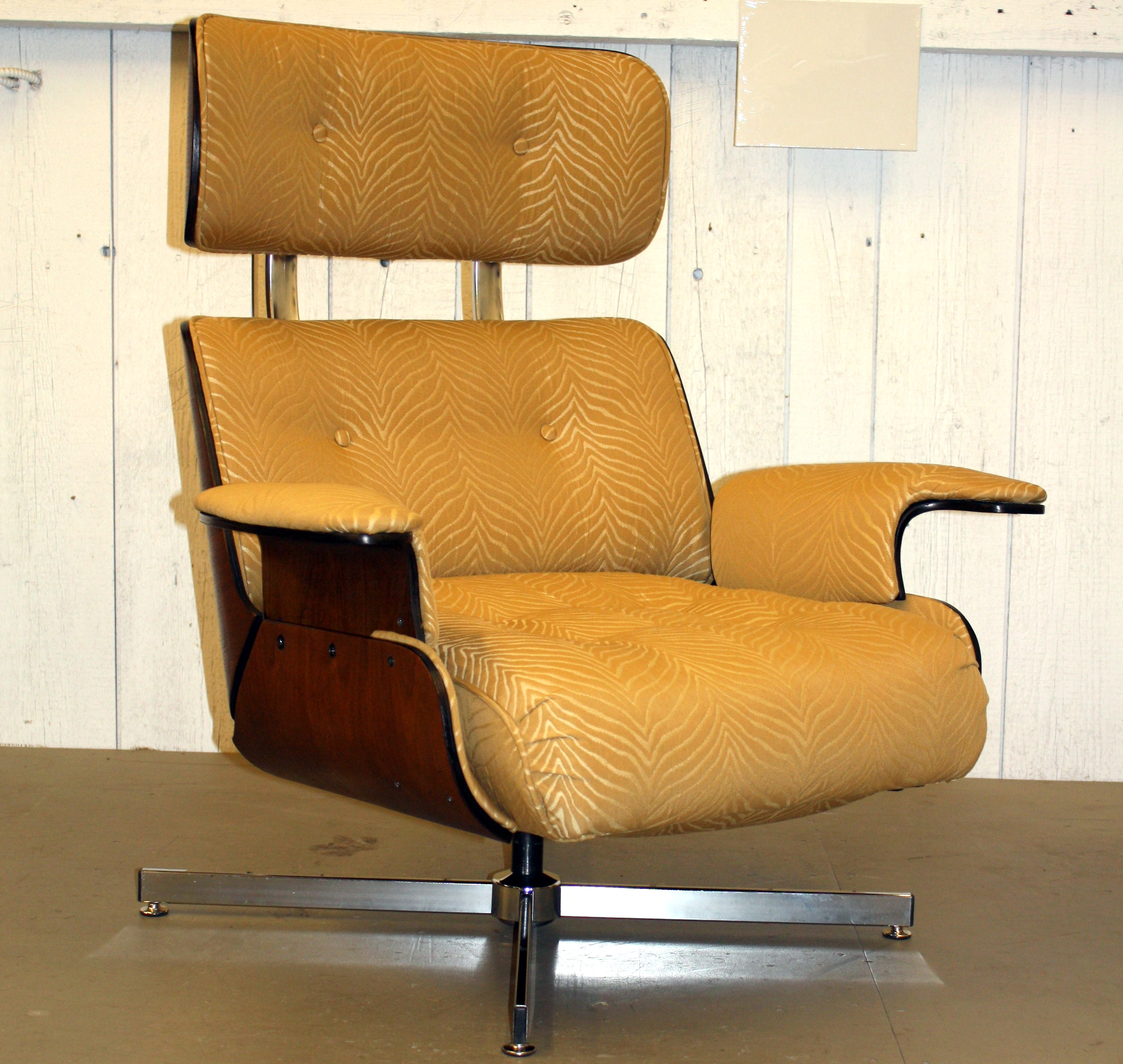 Modern brown office chair with wheels and armrest feature