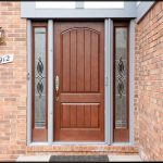 modern front door design with wood panel plus windows and brick walls and wall scone