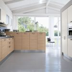 modern kitchen set with wood under storage and glass door cabinets on top mounted modern oven and other kitchen appliances sink and faucet