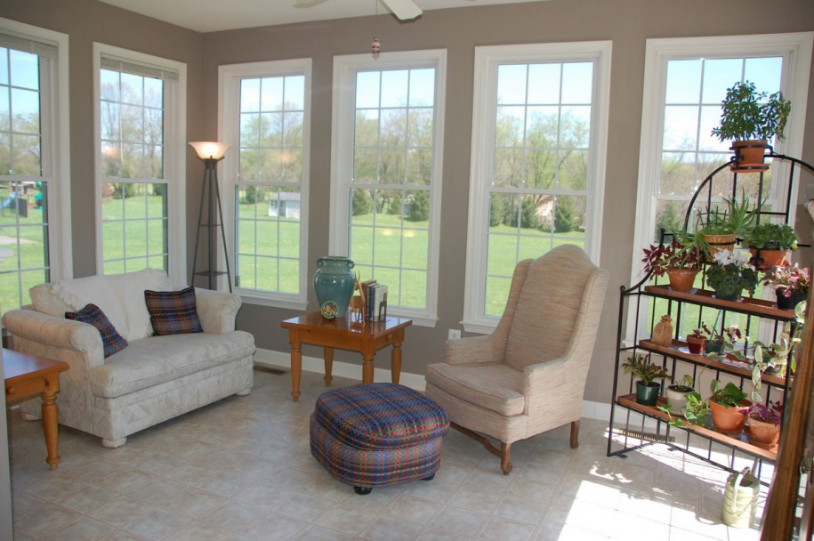 modern sunroom design with a cozy corner sofa a higher back chair a