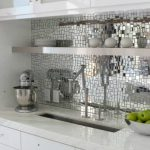 mosaic tiles mirror kitchen backsplash white porcelain kitchen countertop pure white bottom kitchen cabinets glas door top kitchen cabinets  a floating single shelf square metal sink and faucet