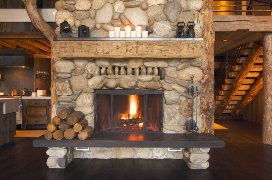 Driftwood mantle steals rustic appeal from the past and - Fotos de chimeneas rusticas ...
