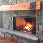 natural driftwood mantle idea upon black fireplace on stone mantle upon wooden flooring idea