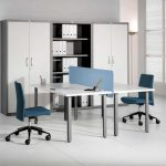 navi blue tow sided desk design with white countertop and light blue partition with truwuoise swivel chairs aside file storage upon white floor
