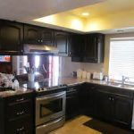 nice yellow ceiling light striked with masculine black cabinet storage in fetching kitchen remodeling contractors