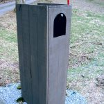 nique modern mail box design with tall idea made of wooden dressed in gray paint with hole and red antena