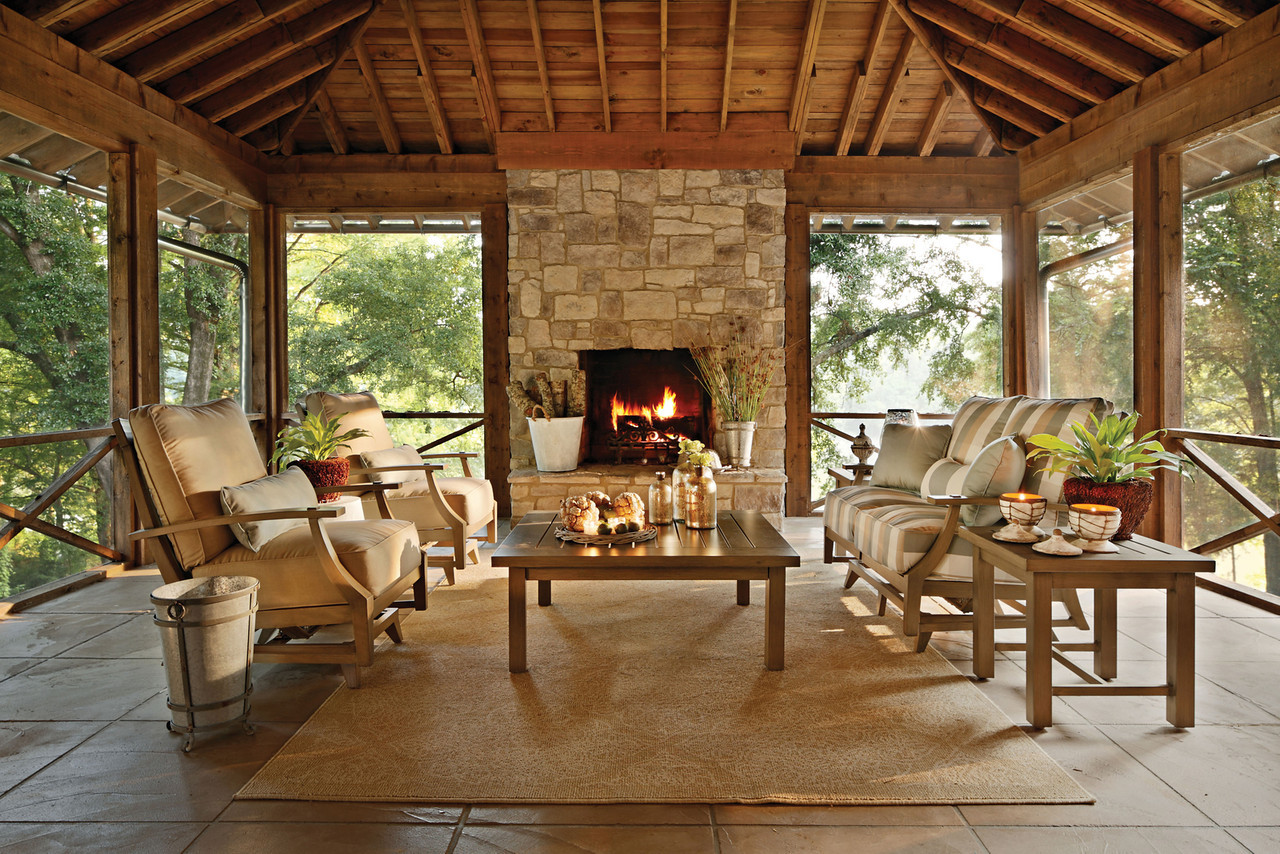 Two sided fireplace warms spacious interior effortless for Porch furniture