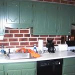 Original Brick Wall Design Feats With Cathy White Countertop And Green Cabinet And Black Appliance In Cool Traditional Kitchen Remodeling Contractors Ideas