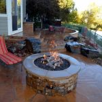 outdoor patio with round and built in fire pit  plus single patio furniture