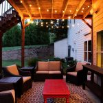 Patio Under Deck With Beautiful Living Space With Sofas And Red Wooden Table And Decorative Lamps Plus Rug