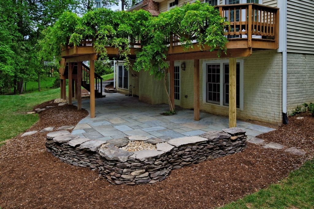 patio under deck with natural stone floor and wooden pillar plus brick pattern wall and wonderful - Patio Under Deck