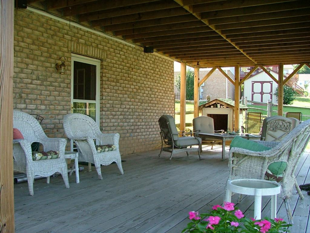 Patio Under Deck With Unique Terrace Armchairs And Small Round Table Plus  Wooden Floor And Brick