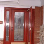 red painted frame fullview storm door produced by Pella