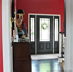 red painted house for amazing interior room ideas with black exterior door and stunning console table decor