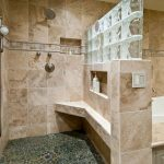 residential master bathroom remodel with walk in shower and bathtub with cool flooring and wooden vanity units with mirror and sink