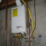 rinnai modern tankless water heater installation indoor on wall plus metal pipes and remote control