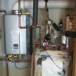 rinnai tankless water heater installation with pipes and wires plus indicators installed on wall