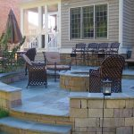 round and permanent fire pit with a set of handcraftmen patio chairs