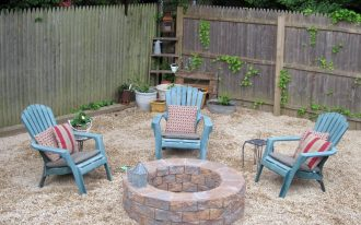 round underground fire pit with brick building  outdoor furniture in blue plus decorative pillows