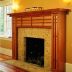 rustic craftsman mantel for traditional fireplace a pair of wall lighting fixtures wood floors
