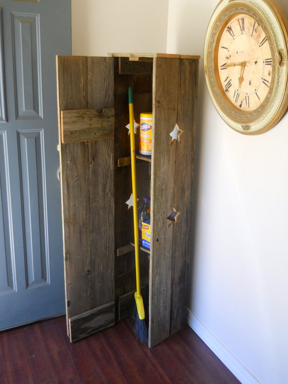 Rustic Wooden Broom Closet Design With Slaped Door And Yellow Broom Aside  Round Clock Upon Wooden