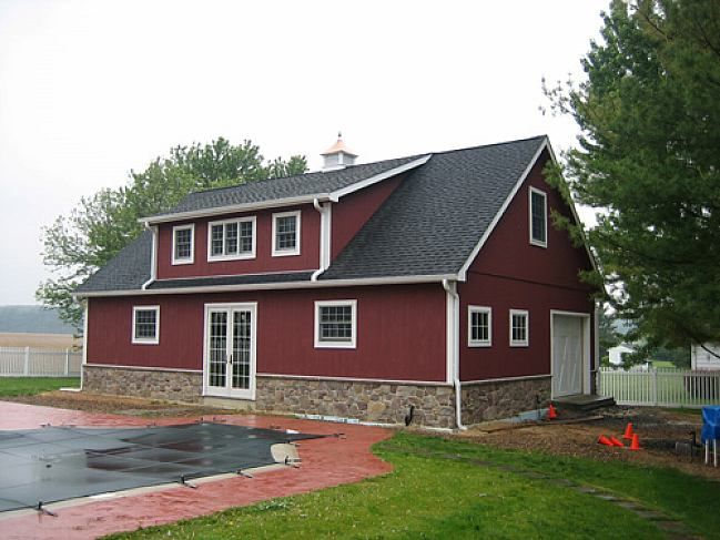 Semi Modern Pole Barn House With Red Painted Metal Siding And Natural Stones Base White Wood