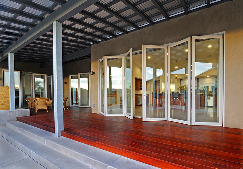 semi opened la cantina glass door with white trims semi red stained wood floors a set & All about La Cantina Doors | HomesFeed