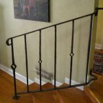 simple and traditional rod iron railing design of wooden staircase in interior wih wall palette