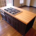 Simple Butcher Block Countertop With Planted Gas Stove