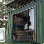 simple glass window design in a container house