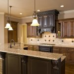 simple kitchen remodeling with wood kitchen cabinets plus backsplashes and pendant lamps combined with wooden floor plus marble countertop and sink