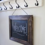 simple-nice-stunning-good-framed-chalkboard-with-brown-wooden-original-concept-hanged-on-a-hook-for-living-room-decoration