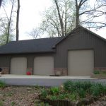 simple pole barn house with metal siding and roofing  three units garage doors