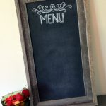 simple-rectangle-brown-old-wood-chalkboard-frame-with-black-board-a-glass-of-red-strawberry-fruit-beige-wall-color-chalkboard-framed-decorations-interior-inspiring-chalkboard-design