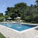 Simple Rectangle Pool Designs With Natural Stones Side Plus Sunbathing Chairs Area In Green Garden