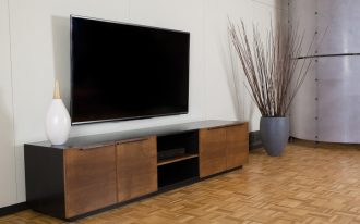 simple rustic console for media with centered DVD player storage  a white decorative porcelain and a blue decorative porcelain laminate floor looks like wood floor