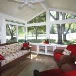 simple sunroom with white ceiling fan a set of elegant furniture in red dominant color a small glass door cabinet system in white color wood floor idea for sunroom