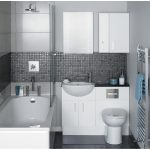 small bath remodel with bathtub and small vanity units with sink and toilet plus wall storage plus cool tile wall and floor