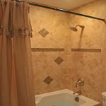 small bath remodel with tile wall and modern bathtub plus bathroom curtain and shower