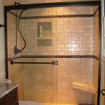 small bath remodel with walk in shower with glass and tile wall combined with toilet and bathroom vanity units