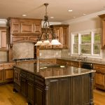 small kitchen remodeling with wood cabinets and marble countertops plus kitchen islands and tile backsplashes added with cool pendant lamps and wood floor