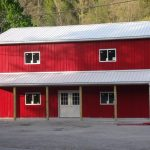 small red metal siding and white roofing pole barn residence with glass door and windows plus their trims