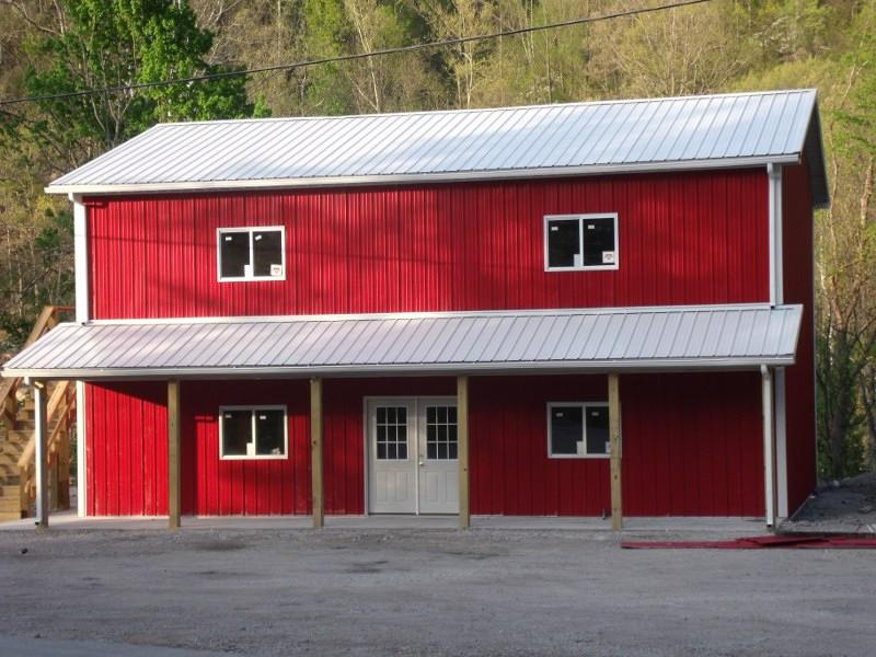 Small Red Metal Siding And White Roofing Pole Barn Residence With Glass Door Windows Plus