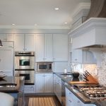 Smart Home Ideas In Kitchen With White Cabinetry And Cool Countertop Plus Kitchen Island With Sinks And Back Splashes Tiles And Pendant Lamps