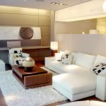 Smart Home Ideas In Living Room With White Sofa And Armchairs Plus Cushions Combined With Wooden Coffee Table With Fur Rug Underneath And Beautiful Lamps And Pictures