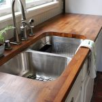 solid wood bucther block countertop for kitchen with double sinks and single metal faucet