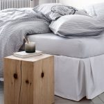 square wood stump side table for bedroom a book and a pencil container a bed furniture